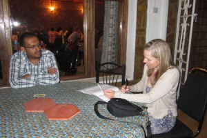 Fuad Abri sitting down with Suzanne Skees (author) for the interview for this blog post.